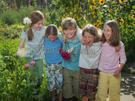 friends smiling together in a garden