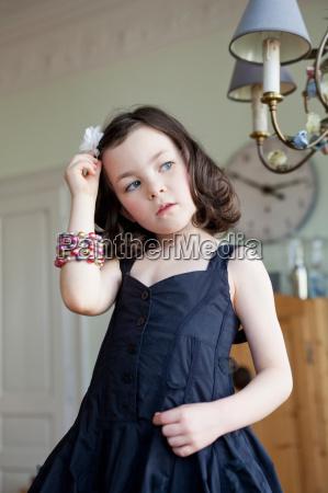 little girl combing her hair