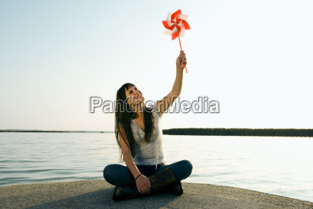 woman holding toy windmill up in