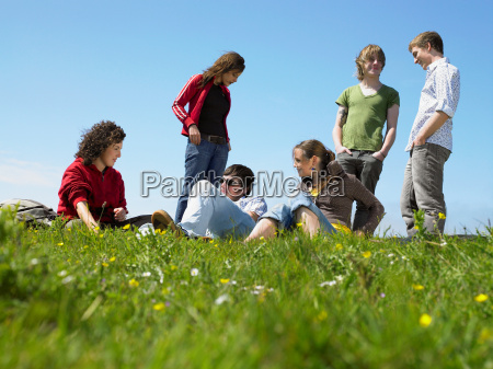 group of young people relaxing
