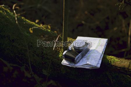 digital camera and folding map on