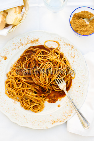 plate of spaghetti with roasted tomatoes