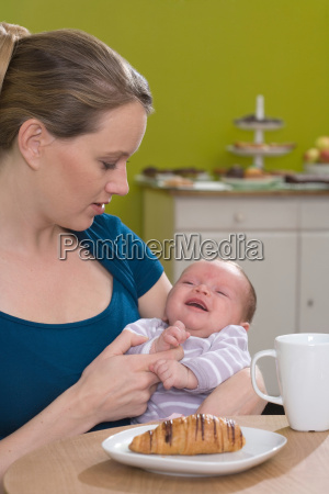 young woman caring for baby