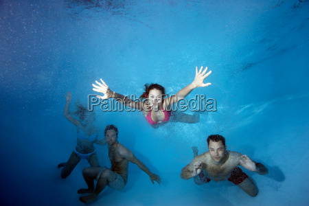 group swimming underwater