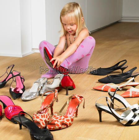 girl trying on her mothers shoes