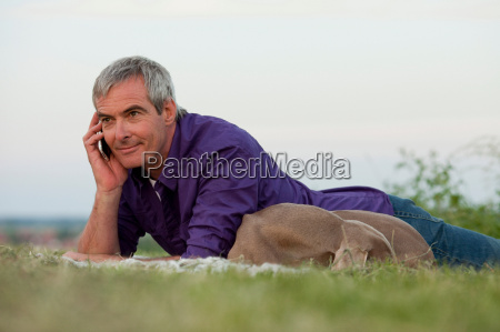 man with dog on the phone