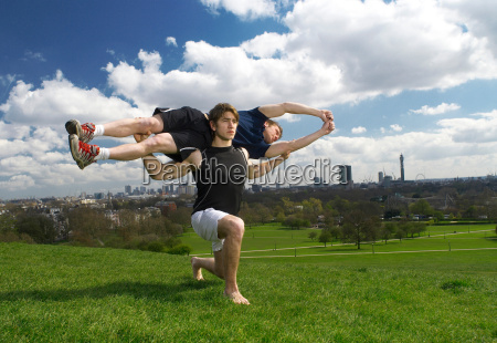 man lunging holding friend