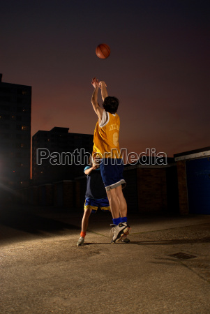 basketball player jumping and shooting
