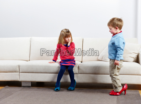 young boy and girl walking in