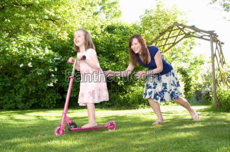 mother chases daughter in garden