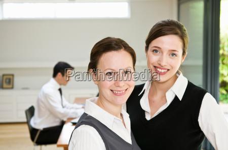 2 happy business women in office