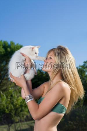 kitten puts paw to teen girls