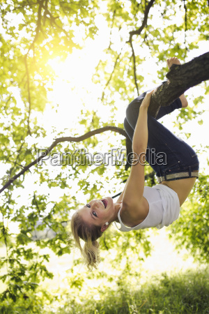 young woman hanging upside down and