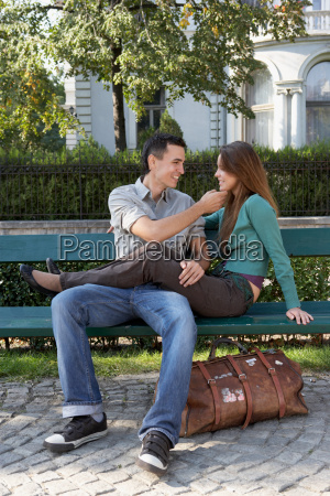 couple sitting on a bench smiling