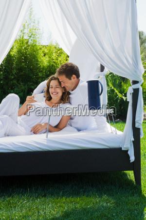 couple having breakfast on bed in