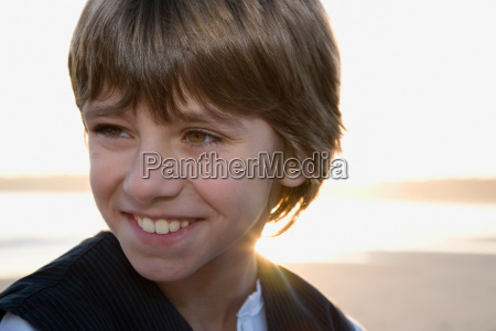 young boy looking out to sea