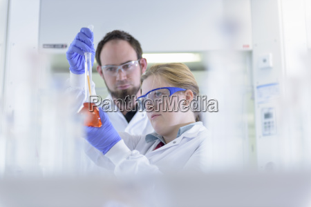 scientists inspecting coloured samples in testing