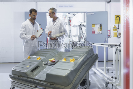 scientists inspecting lithium ion car battery