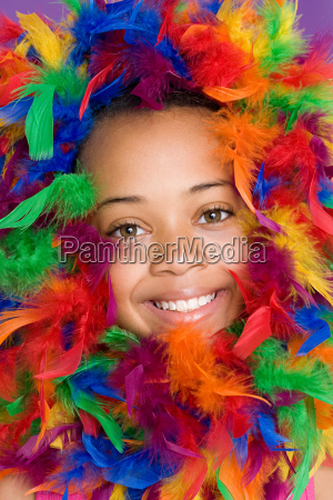 girl with feathers around her face