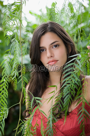 young woman amongst leaves