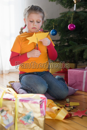a girl cutting out a star