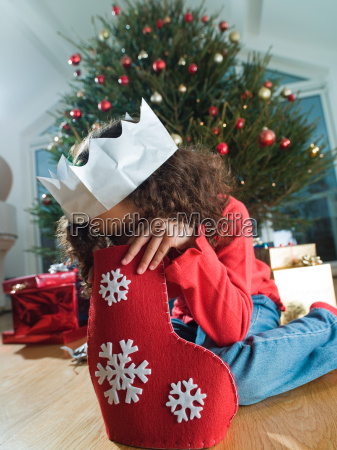girl looking in a christmas stocking