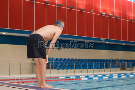 a mature man about to dive