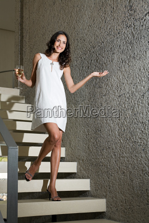 woman on stairs with a glass