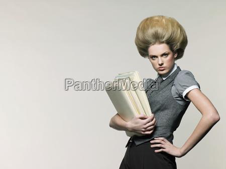 businesswoman holding files