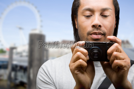 a young man taking pictures