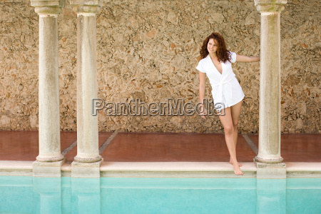 young woman by swimming pool