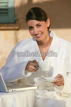 woman in bathrobe with coffee and