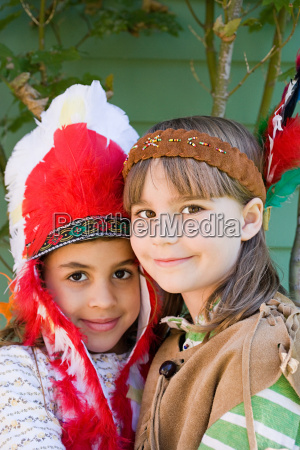 two girls in native american costumes