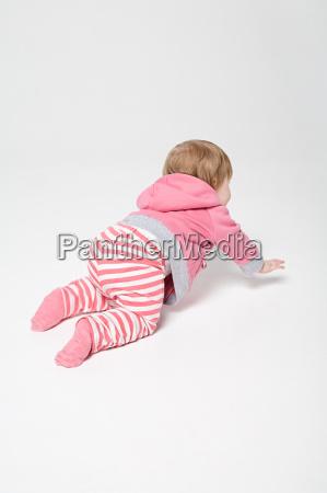 a baby girl crawling