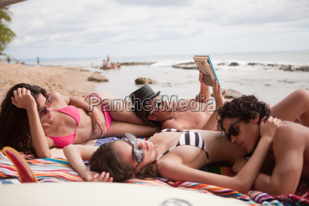 four young friends on beach vacation