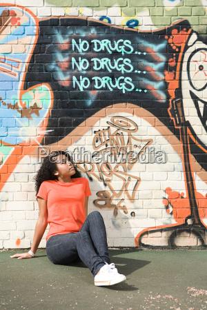 girl looking at graffiti