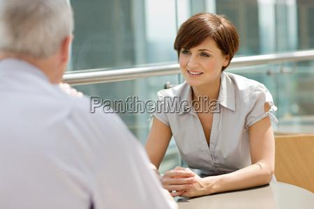 businesswoman and businessman talking