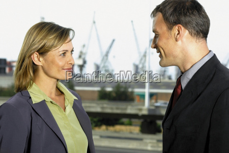 businessman and businesswoman meeting outside