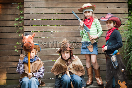 children dressed up as cowgirl bear