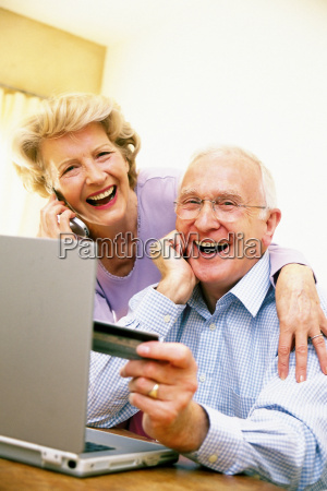 man and woman using laptop computer