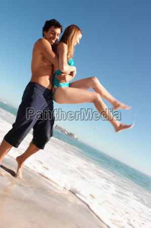 man holding a woman on a