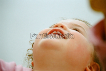 female toddler looking up