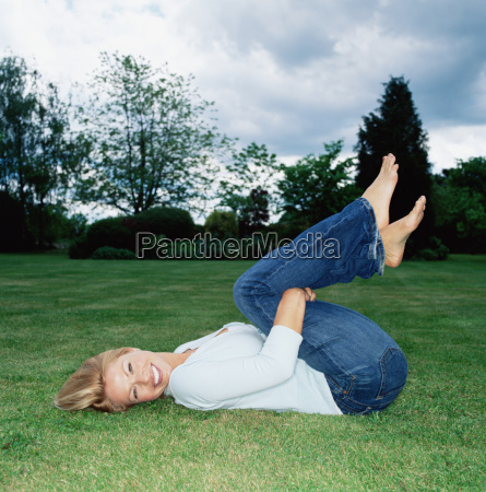 young woman on grass in park