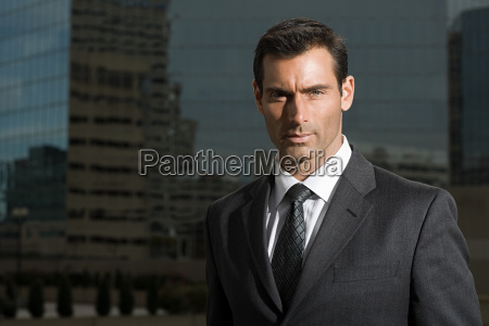 portrait of a businessman against a