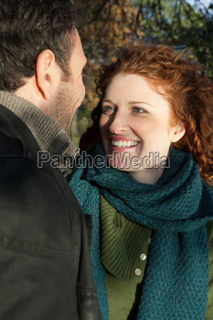 a smiling woman looking at her