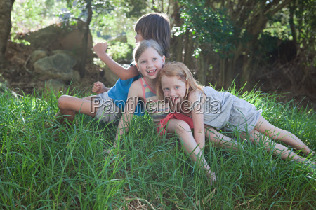children sitting on grass