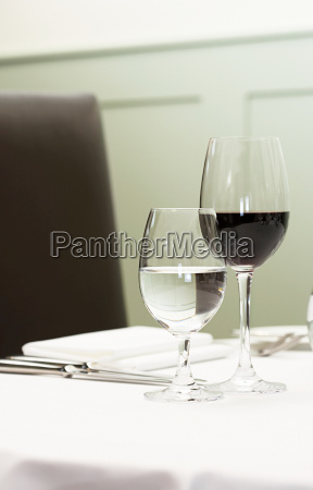 a glass of water and red