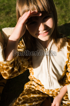 girl dressed in giraffe print costume