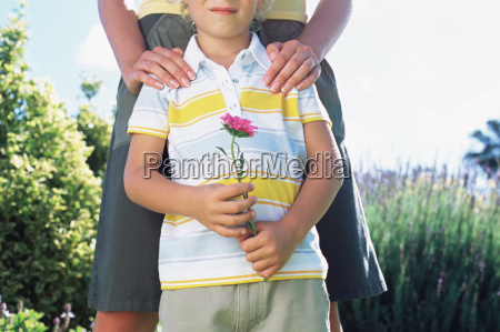 mother with son holding flower