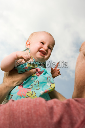 father holding baby girl
